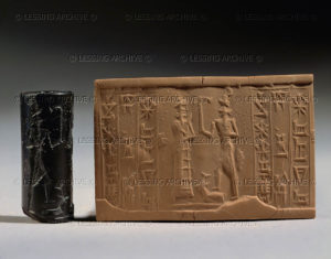 Cylinder seal and imprint, Paleo-Babylonian, from Tello Offering scene before a god brandishing a curved stick. Haematite, H: 2,8 cm MNB 1471