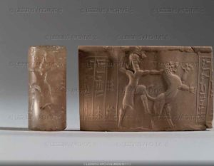 Cylinder seal and imprint, Neo-Babylonian, 612-539 BCE. A man or deity subduing a lion. Chalcedony, H: 3,6 cm AO 22353