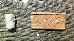5g - early man & woman drinking in early Mesopotamia