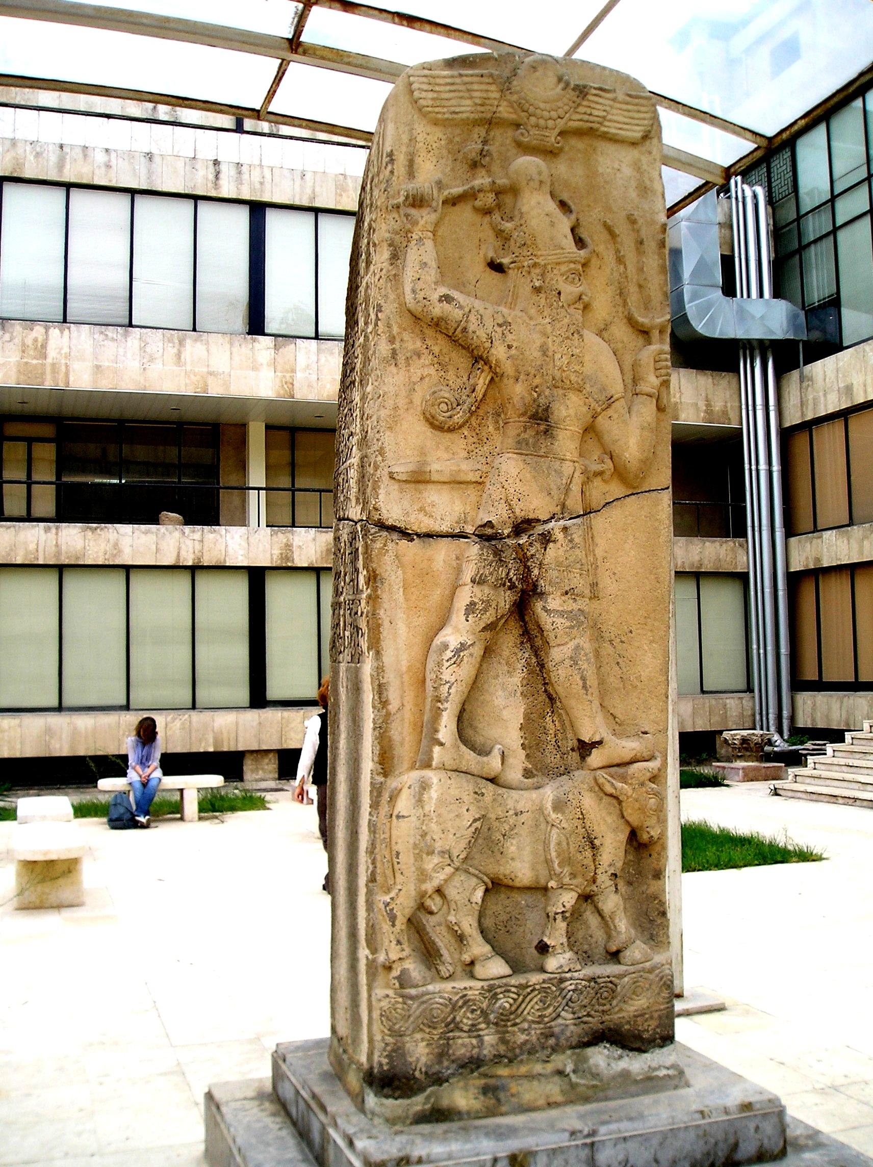 Adad - Teshub stele artefact, 3rd main son to Earth Colony Commander Enlil, powerful lethal weapons of the thunder god, flying disc symbol of Nibiru above him, alien giant Adad, who battled time & time again, against his cousins on Enki's side of King Anu's descendants