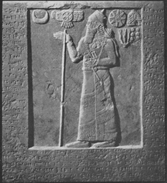 14f - Assyrian artefact of King Assurnasirpal II displaying many symbols of individual giant alien gods, Nannar's moon crescent symbol, fying disc symbol of their trip from planet Nibiru, the 8-pointed star symbol of the King of Nibiru, Anu, the 3-pronged weapon of Adad, the 7-balls / 7th planet symbol of Earth Colony Commander Enlil, the heir to Anu, & the animal-horned hat of the Royal Anunnaki, Anu's direct descendants on Earth Colony