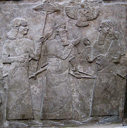 14r - Ashurnasirapal II with official after battle, the god Ashur oversaw peace agreements, wars, food supplies, & all else that concerned their needs & desires, these ancient artefacts depicting flying protector gods over their mixed-breed son-kings, are obvious direct contradictions to all main religions today, also to government power brokers, secret societies, elite groups, & so on, some want them hidden away, some want them set aside as myths, Radical Islam wants them all destroyed, all fear the truth be known