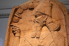 16a - Assyrian artefact of King Shamshi-Adad V of Assyria 824 - 811 B.C., he is pointing to symbols of the gods, the ones that put him in power, protected him while in power, & directed him in every way