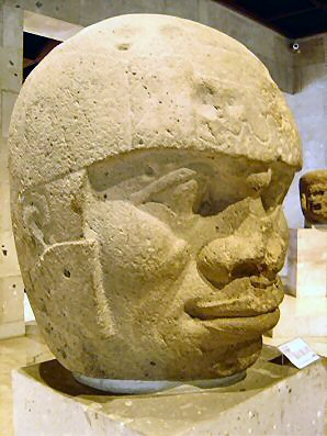 2j - Olmec head artefact, possibly a king's head, hundreds of Olmec heads have been discovered so far, kings carved in succession, Olmec's are black Africans shipped to the Yucatan by Ningishzidda due to his expulsion from Egypt by his brother Marduk, the 1st earthlings to inhabit So. America, as dislpayed by Sitchin in the Mexico City Museum
