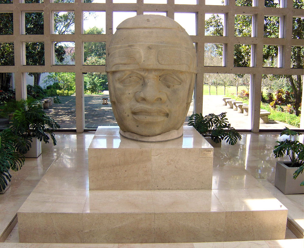 2o - Olmec head artefact, possibly a king's head, hundreds of Olmec heads have been discovered so far, kings carved in succession, Olmec's are black Africans shipped to the Yucatan by Ningishzidda due to his expulsion from Egypt by his brother Marduk, the 1st earthlings to inhabit So. America, as dislpayed by Sitchin in the Mexico City Museum