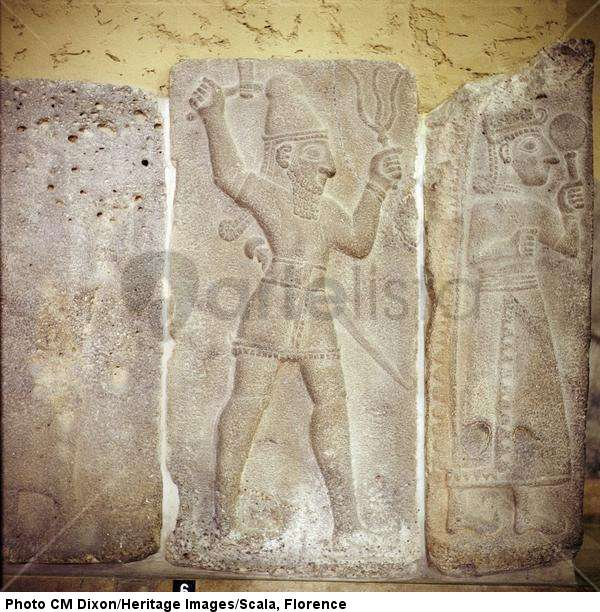 3a - Hadad with his weapon symbol & his aunt-spouse Shala, all tribes of ancient people, all over the world, were well aware of the giant god Adad from the skies, wall relief artefact, artefacts of the gods are shamefully being destroyed by Radical Islam, attempting to eliminate ancient evidence that directly contradicts the 7th century teachings of their prophet