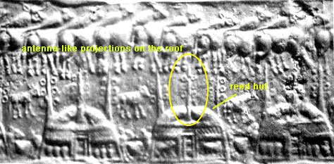 8e - reed huts with antenna type poles, communications all around were established by the alien gods of Sumer, 1st reed hut housing, then came mud brick housing for the gods, as it was later for earthlings taught by the alien gods