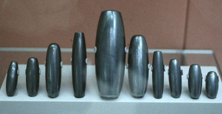 ancient artefacts of Babylonian weights, commerce between city-states used standardized weights of measure, knowledge of the gods given to earthlings