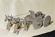 appx. 3,000 B.C. artefact of a chariot drawn by oxen, man was given the wheel for uses of hauling, travel, trade, & war