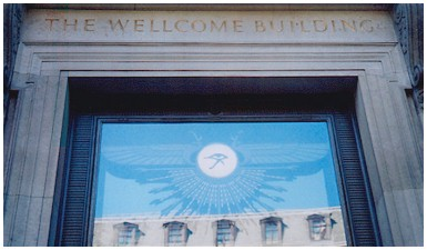 3d - alien flying disc prominent on the Welcome Trust Building, a Masonic medical charity, flying discs are found everywhere in Mesopotamia, some with pilots shown, some not, this symbol is very much around today