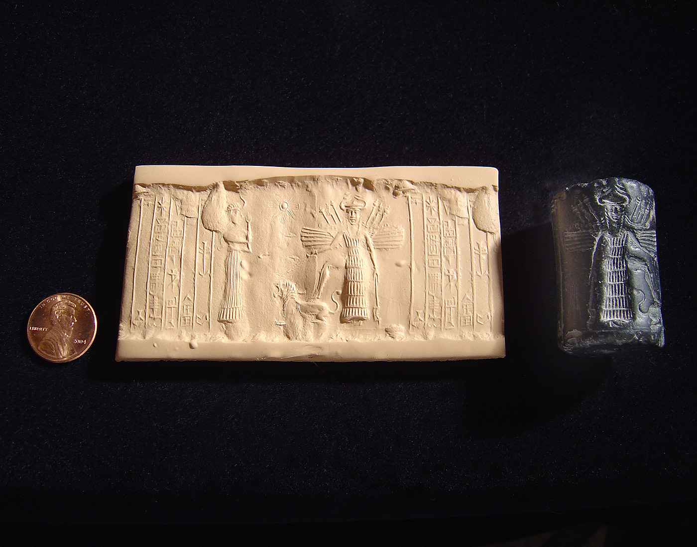 3r - Ninshubur & Inanna imprinted on wet clay with reversed-carved rolled rock forming a seal, winged Inanna holds high-tech alien weapon, misunderstood by earthlings, she placed one foot upon her zodiac symbol - Leo the Lion, her 8-pointed star symbol of Venus is faintly just off her right shoulder