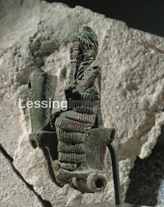 Figurine of a god mounted on a chariot. His crown is in the shape of a coiled snake. From Susa,Iran. Copper, H: 15,7 cm Sb 2824
