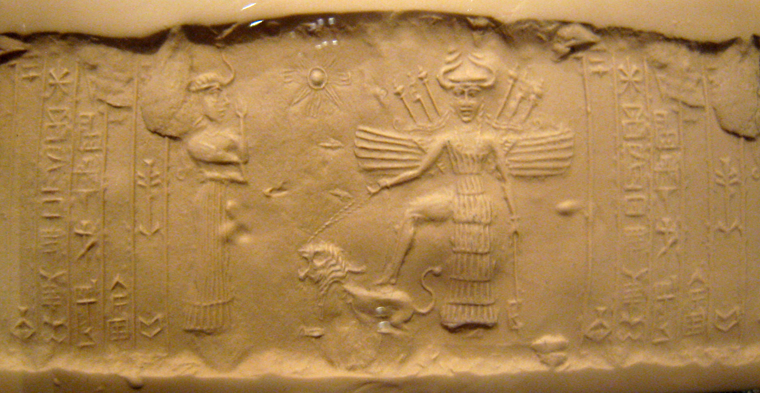 Ninshubur & Ishtar - Inanna on an ancient Mesopotamian seal artefact, Inanna with her high-tech alien weaponry, standing upon a lion, her zodiac sign of Leo, artefacts of the alien gods & goddesses are shamefully being destroyed by Radical Islam, fearing the ancient evidence depicted over & over again, erodes their credibility as religious power-brokers of Islam