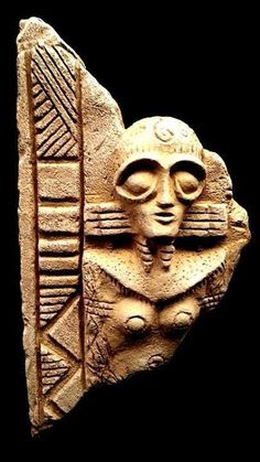 stele of alien goddess Inanna in her flight suit & goggles