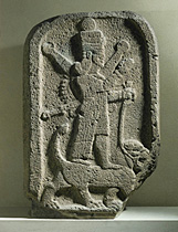 2m - Inanna stele, atop her Leo - lion symbol holding alien high-tech weaponry