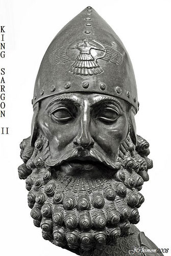 19b - mighty man Sargon-II, king of Assyria 722-705 B.C.; his protector, alien god Ashur, in his sky-disc engraved onto his helmet