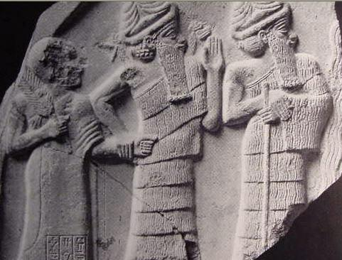 3 - ancient Lagash King Gudea, Ningishzidda with his 2-horned serpent symbol over his shoulders, & younger brother Dumuzi