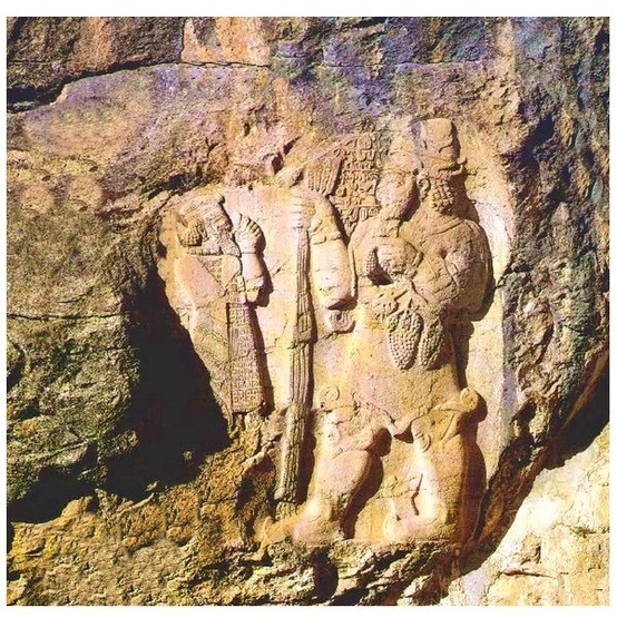 18 - Hittite rock carving of smaller king & his giant god Adad