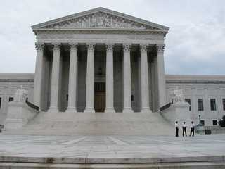 99 - giant gods & mixed-breeds carved into Supreme Court Building